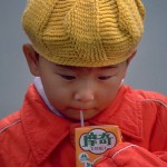 344px-Chinese_child_drinking_from_juicebox-150x150